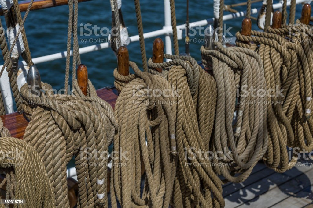 Ropes and wooden bollards on a sailing ship stock photo