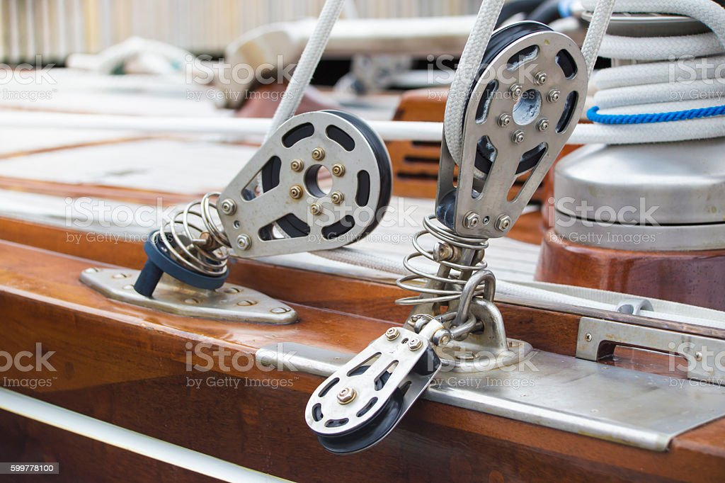 Ropes fastening mechanisms in a yacht stock photo