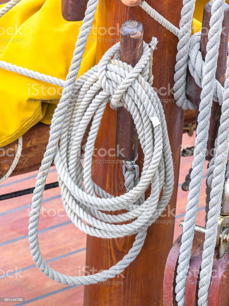 Ropes on the blocks on an old sailing boat stock photo
