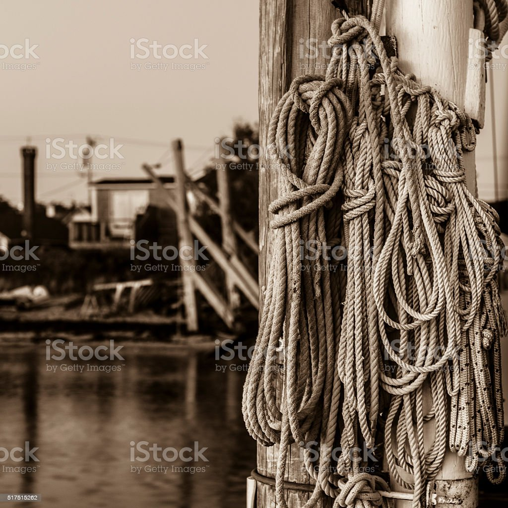 ropes tied up at fishing dock stock photo