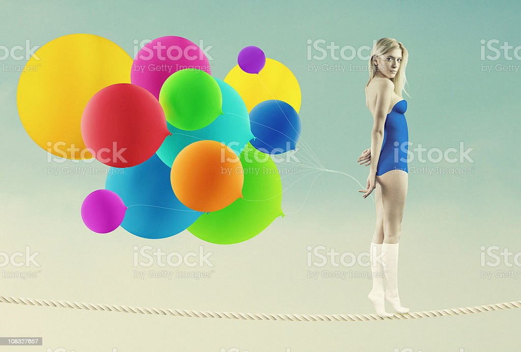 rope-walker girl stock photo