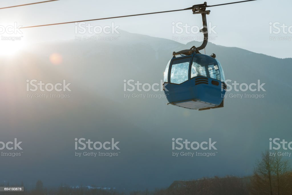 Ropeway and cable car transport system for skiers stock photo