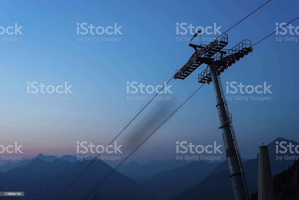 ropeway with moutnains at night stock photo