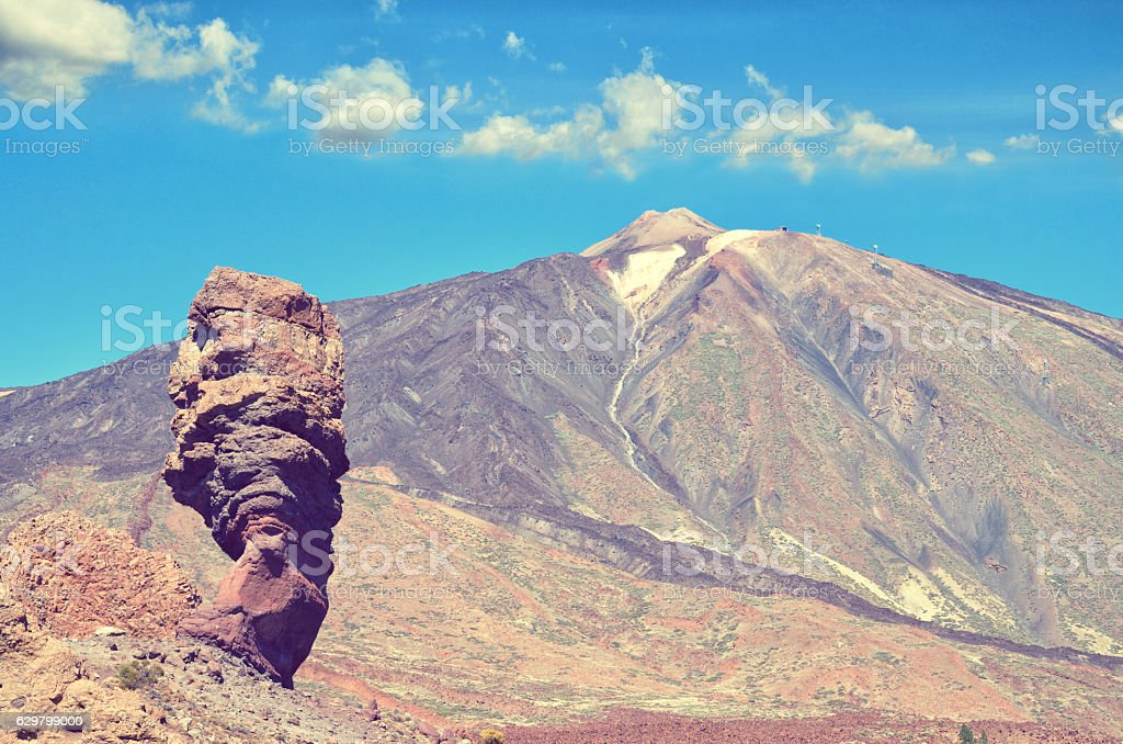 Roques de Garcia and Pico del Teide volcano in background. stock photo