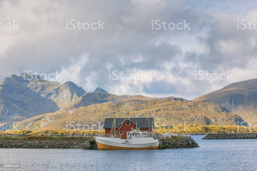 Rorbu and Boat in a Fishing Village of Lofoten, Norway stock photo