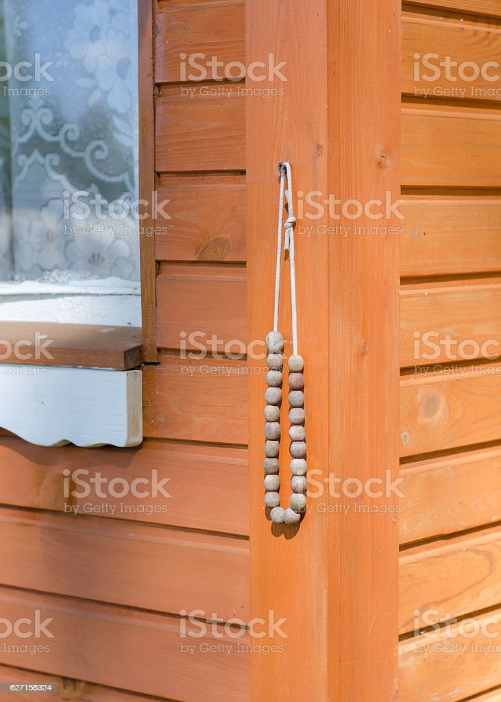 Rosaries hanging at the entrance to the house. stock photo