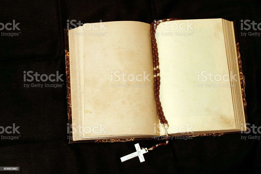 Rosary and empty pages book royalty-free stock photo