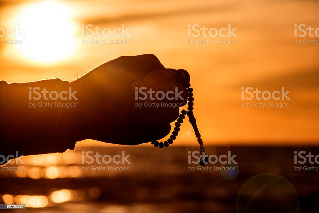 Rosary and sunset. stock photo