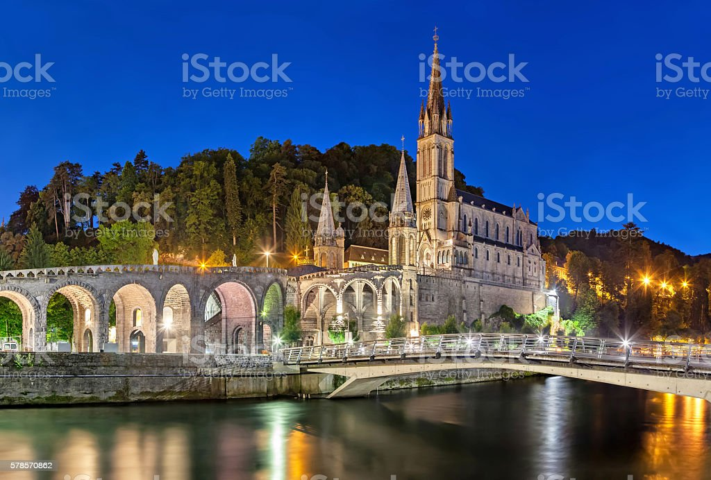Rosary Basilica at night in Lourdes stock photo