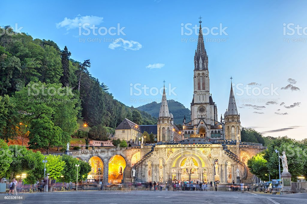 Rosary Basilica in the evening in Lourdes stock photo