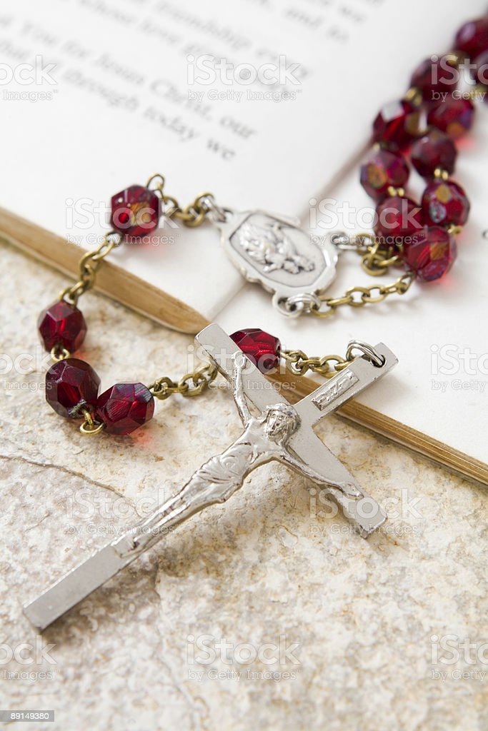 Rosary beads on a book of psalms royalty-free stock photo