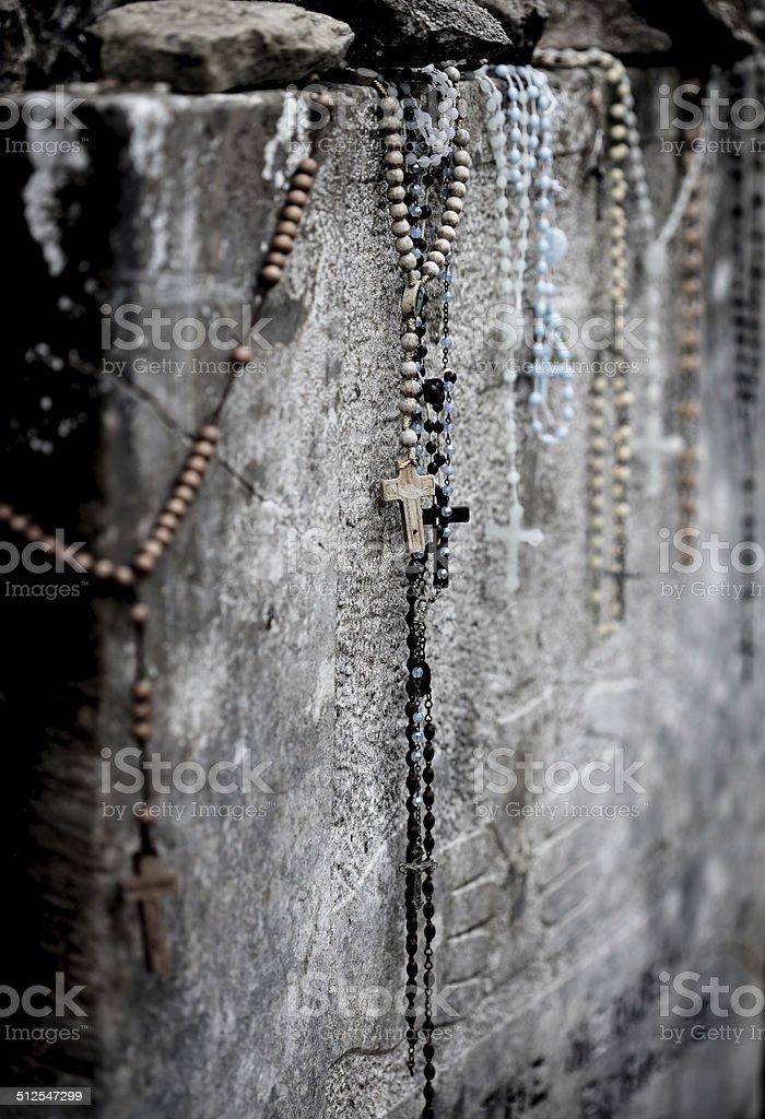 Rosary beads on gravestone royalty-free stock photo
