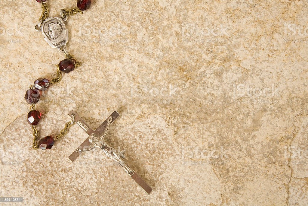 Rosary beads on stone with space for text royalty-free stock photo
