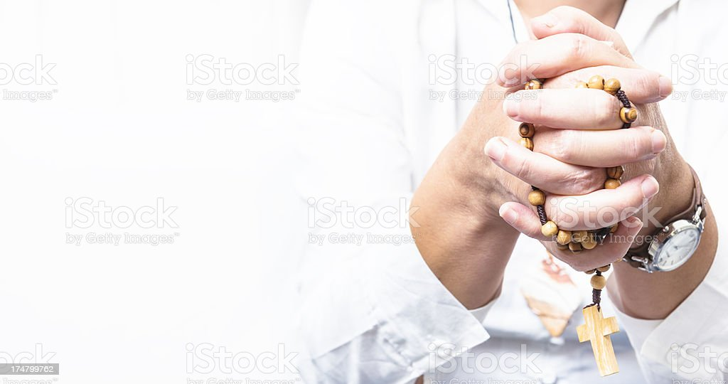 Rosary beads praying - 60's stock photo