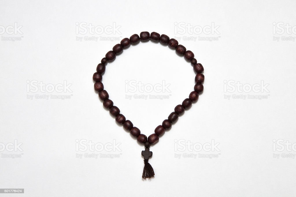 rosary cross on white  background stock photo