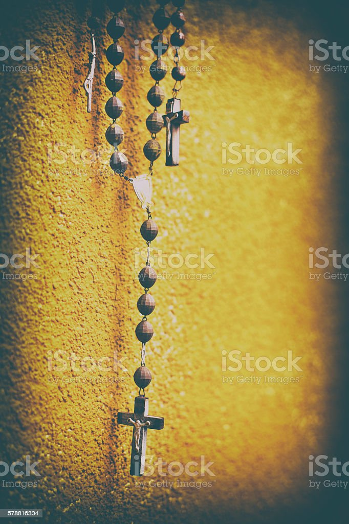 Rosary, Cross, Orange wall stock photo