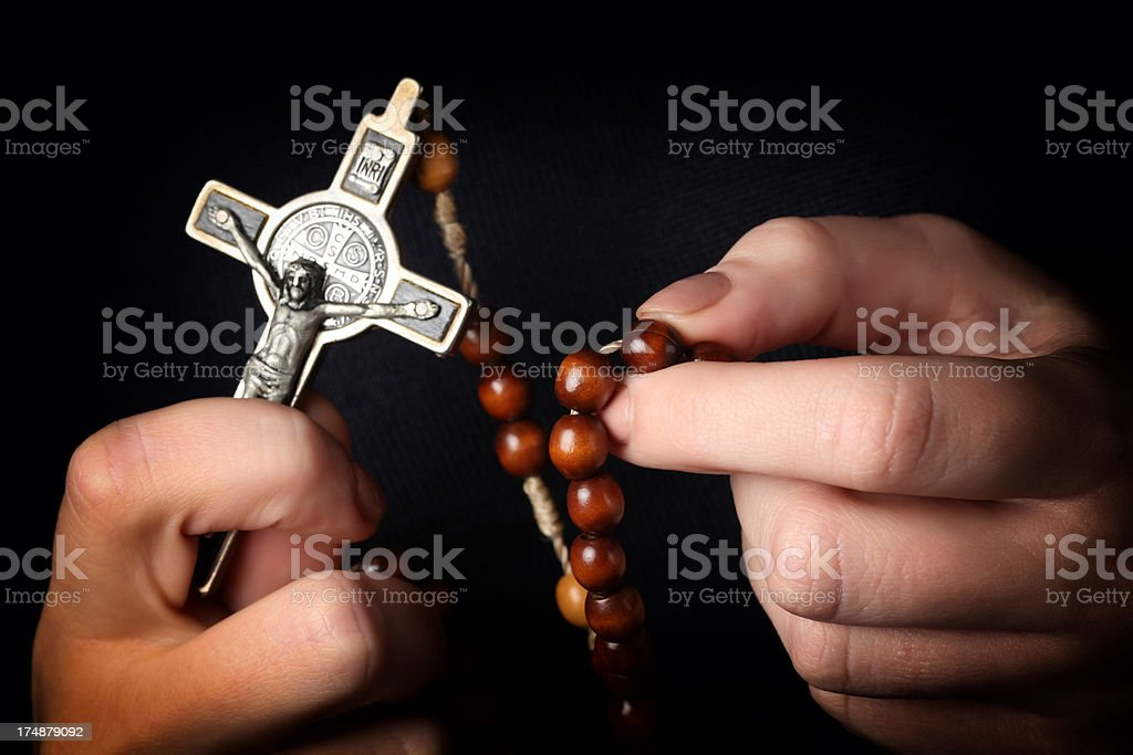 Rosary in Hands stock photo