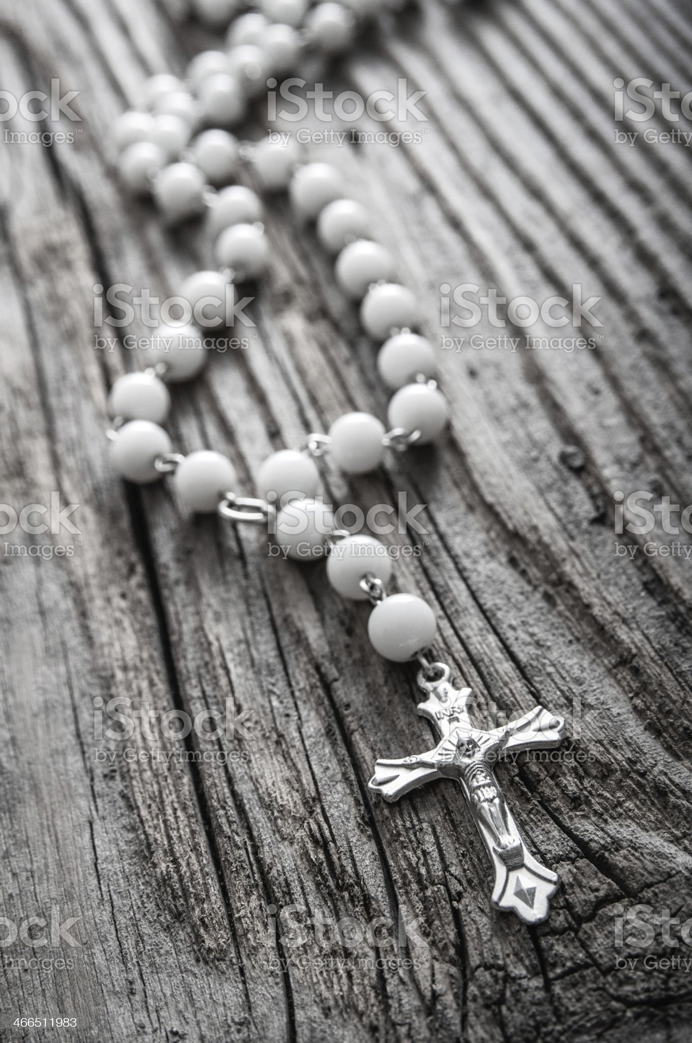 Rosary on old wooden background royalty-free stock photo