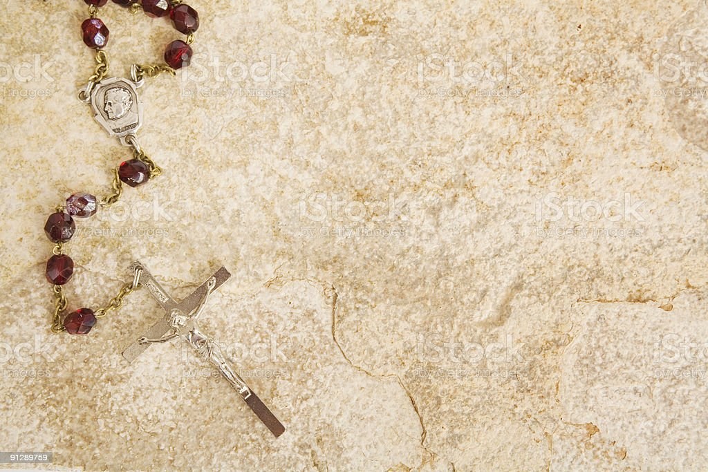 Rosary on stone with copy space royalty-free stock photo