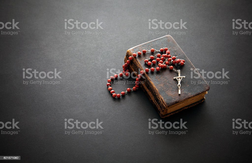 Rosary on the old Bible stock photo