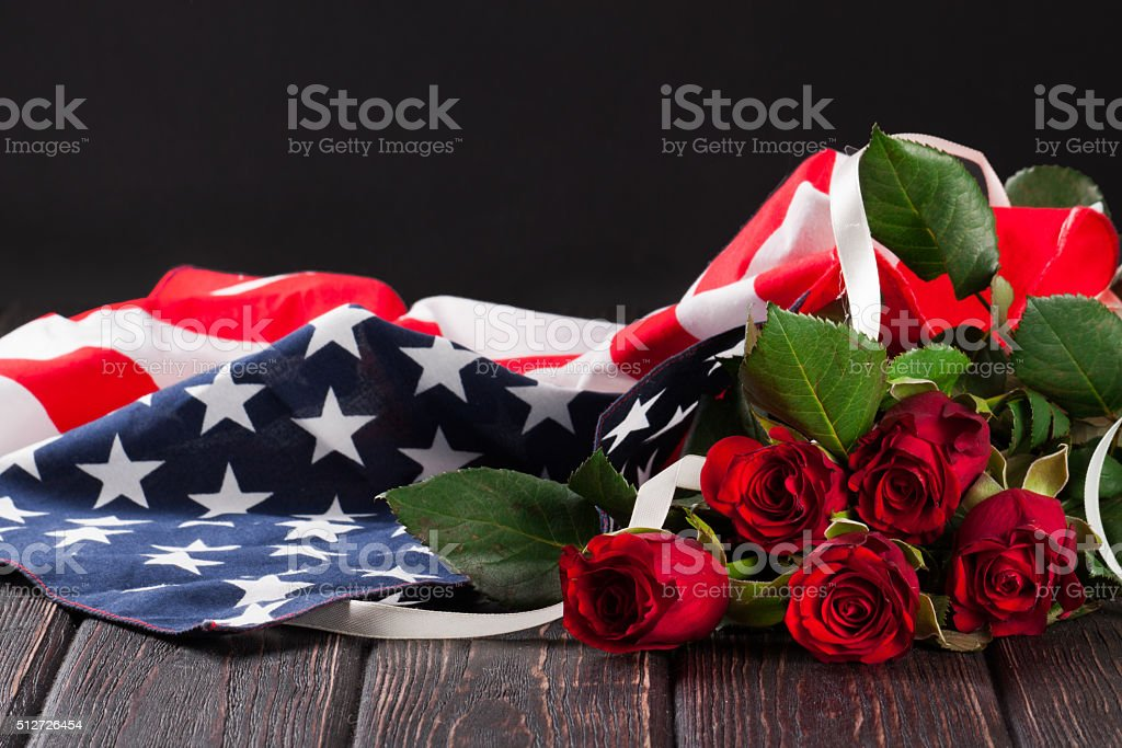 Rose and american flag on wood stock photo