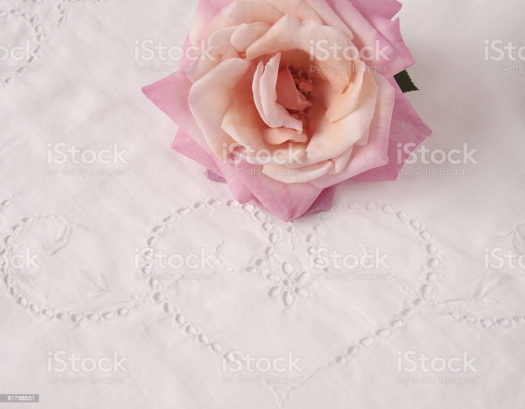 rose and eyelet heart stock photo