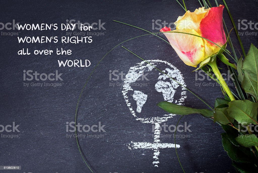Rose and female sign with earth globe on a blackboard stock photo