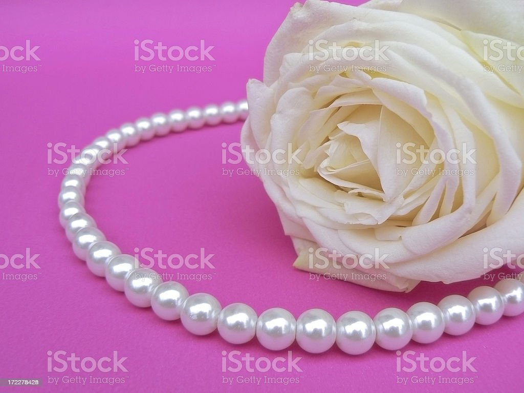 Rose and pearls. royalty-free stock photo