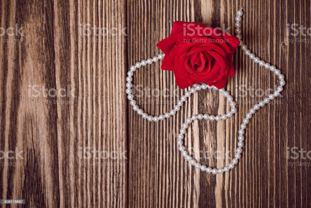 Rose and white pearl necklace stock photo