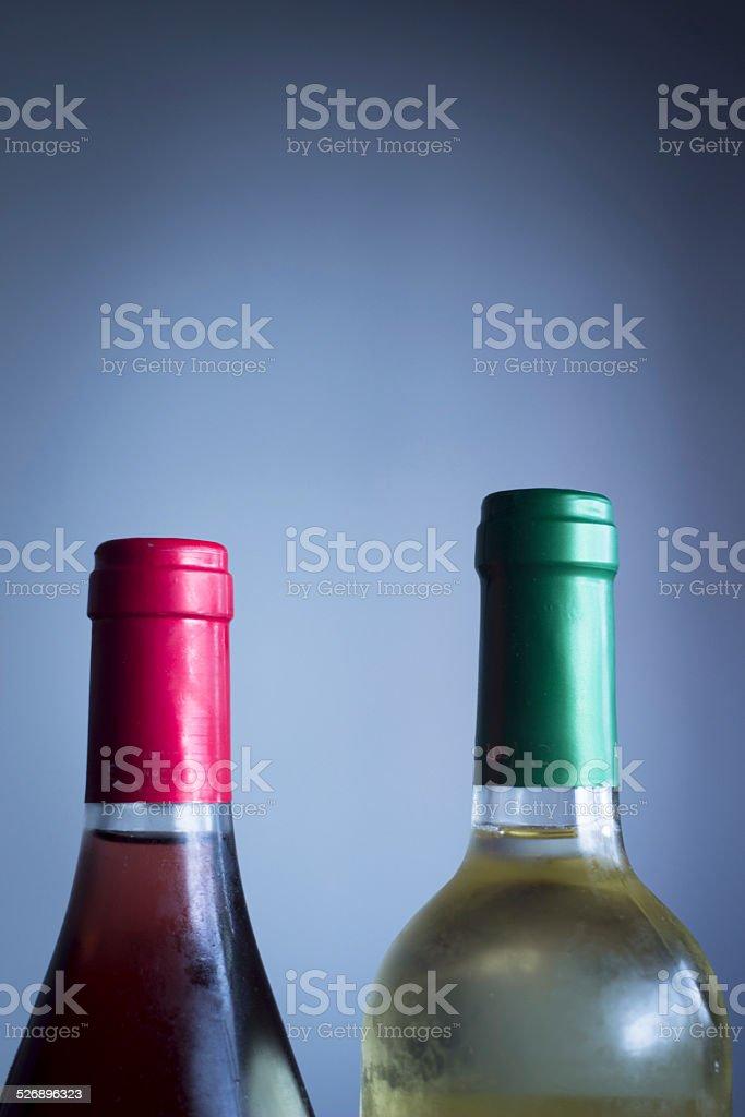 Rose and white wine bottles studio isolated stock photo