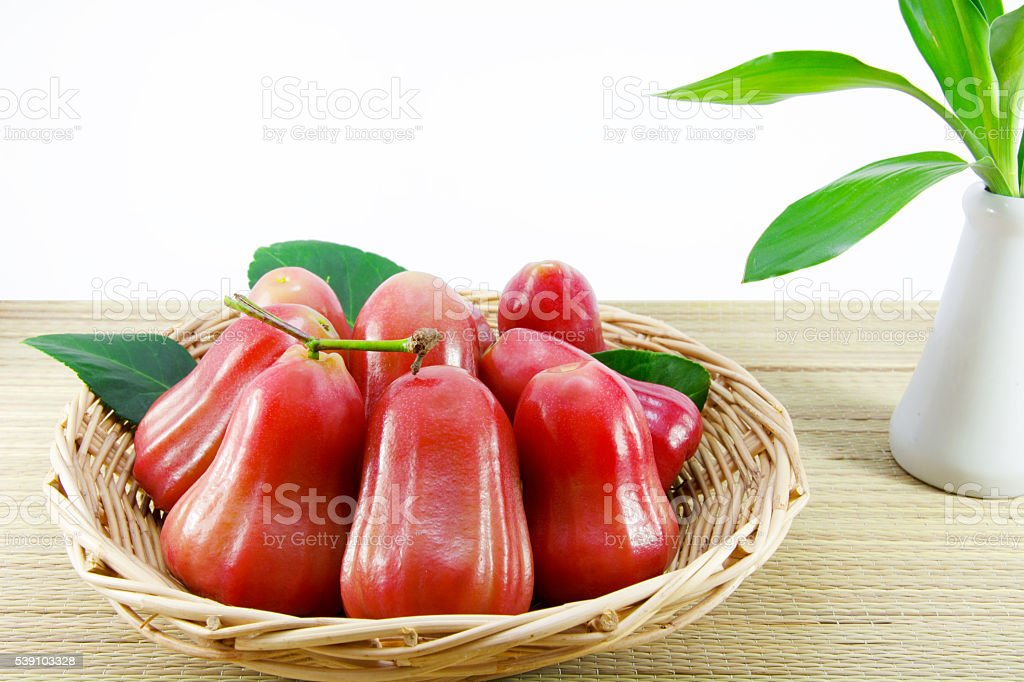 Rose apple in a basket stock photo