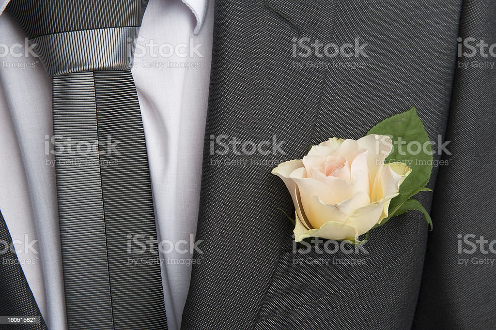 rose boutonniere flower on groom's wedding coat royalty-free stock photo