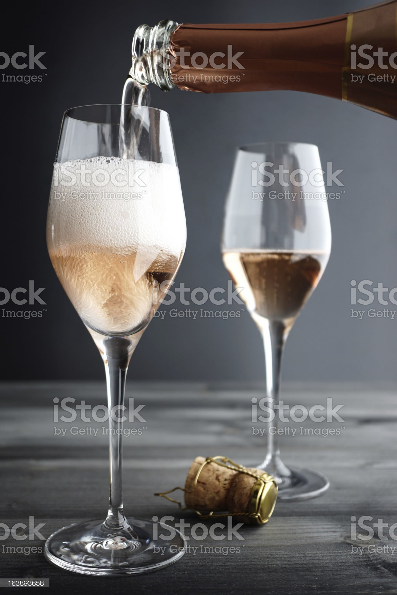Rose Champagne being filled into Glass royalty-free stock photo