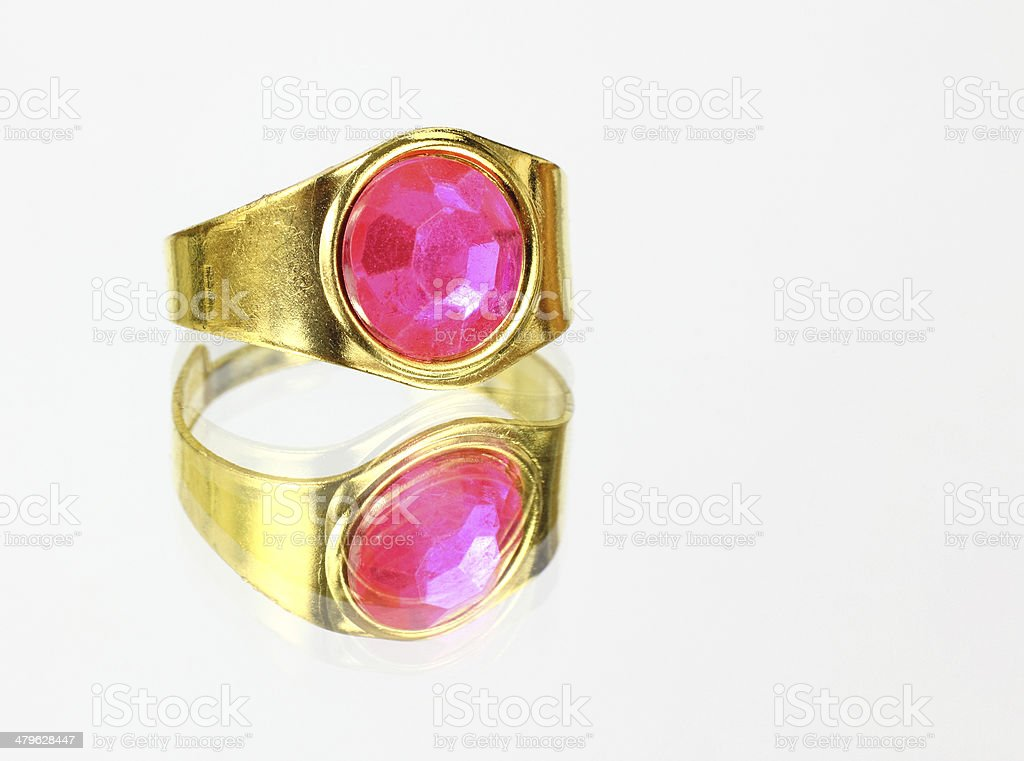 Rose colored ring on mirrored surface stock photo