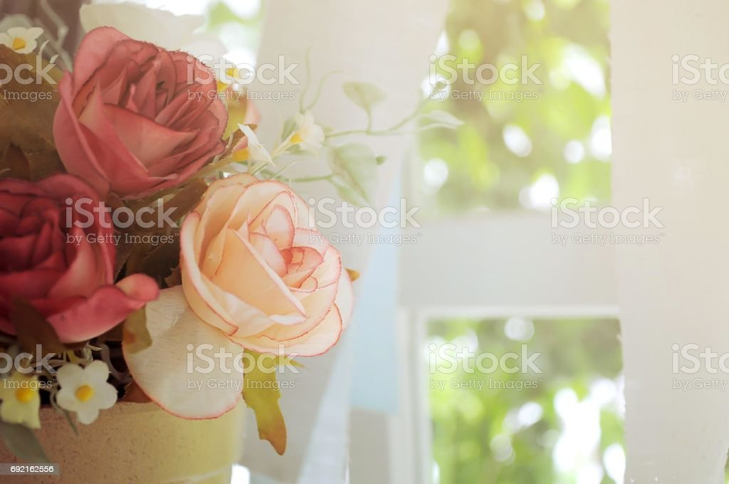 Rose fake flower with sunlight for background stock photo
