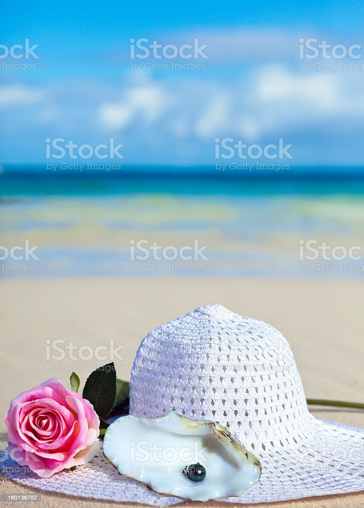rose flower, hat and black pearls of Tahiti royalty-free stock photo