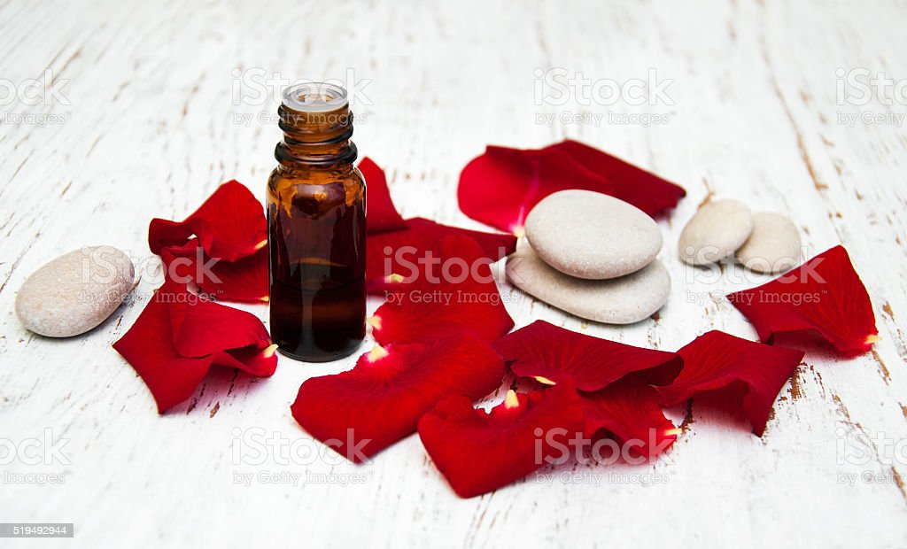 rose flower petals with aromatherapy essential oil stock photo