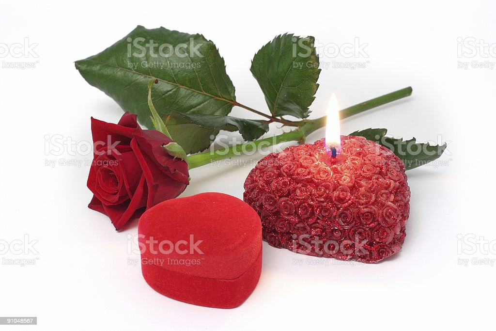 Rose, gift and candle royalty-free stock photo
