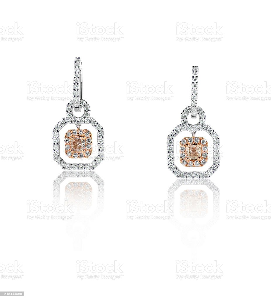 Rose gold and white gold diamond earrings stock photo