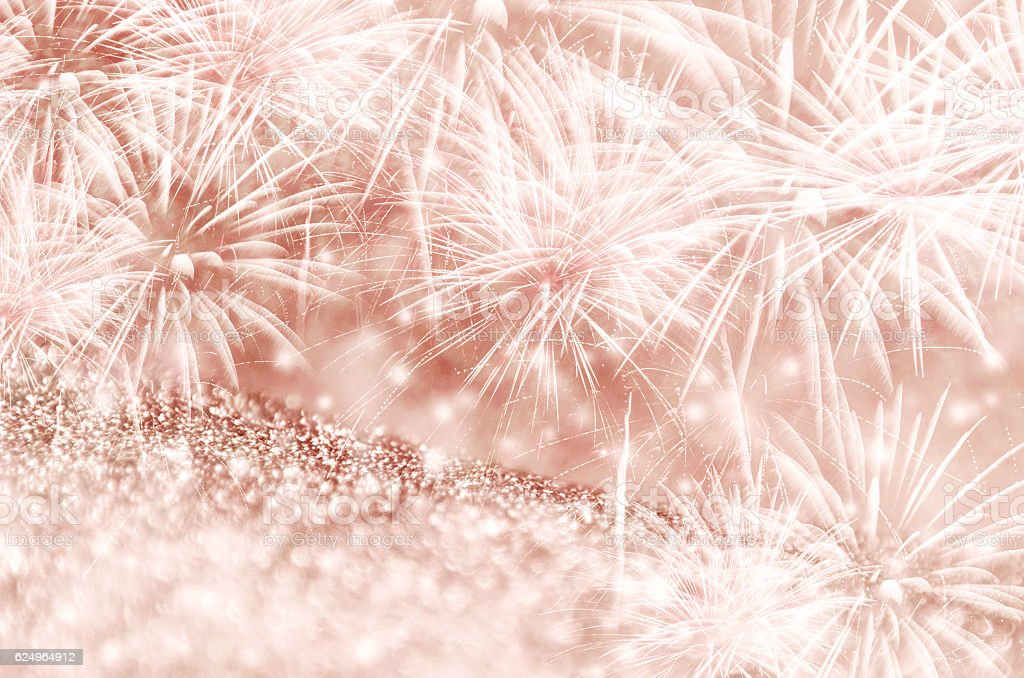 Rose gold fireworks at New Year stock photo