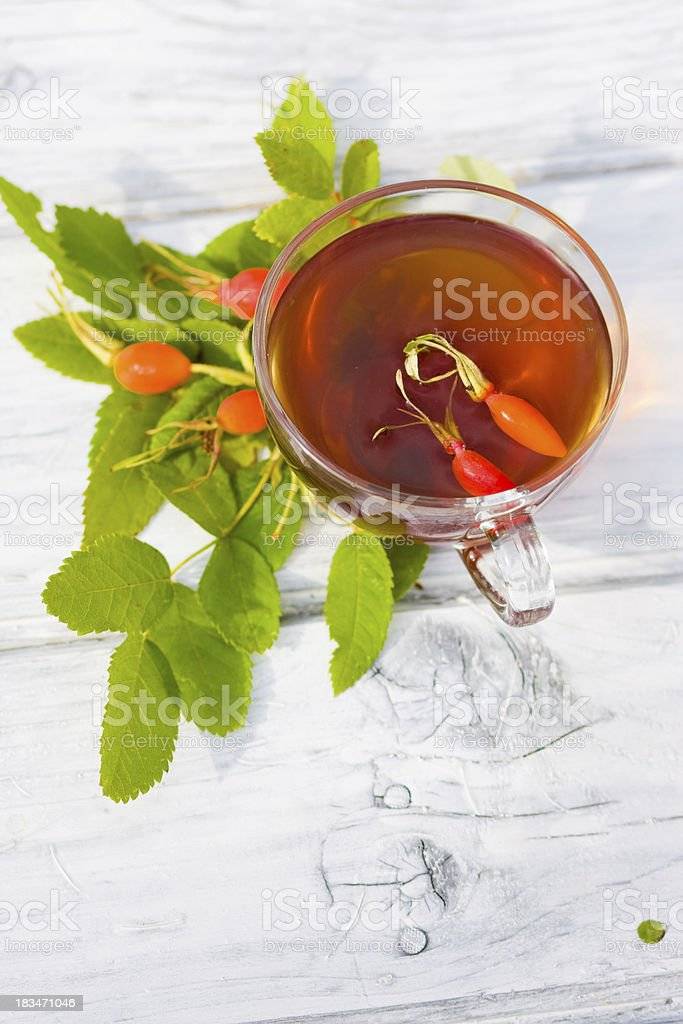 Rose Hip Tea on wooden background royalty-free stock photo