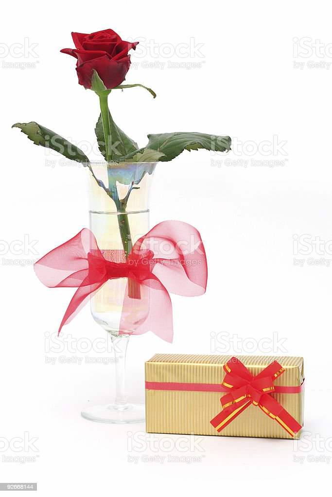 Rose in vase and gift royalty-free stock photo