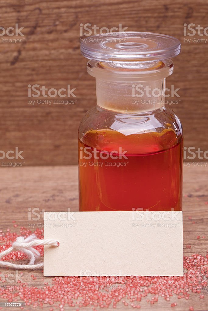 rose oil in a bottle with label royalty-free stock photo