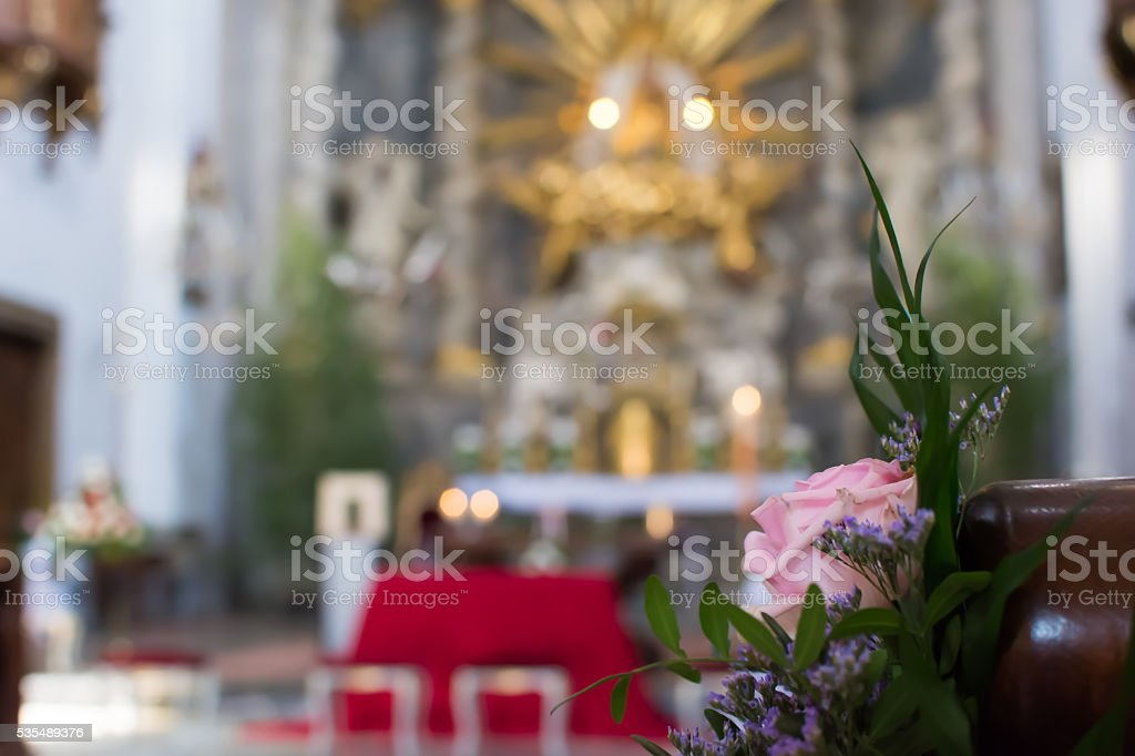 Rose on a pew for wedding stock photo