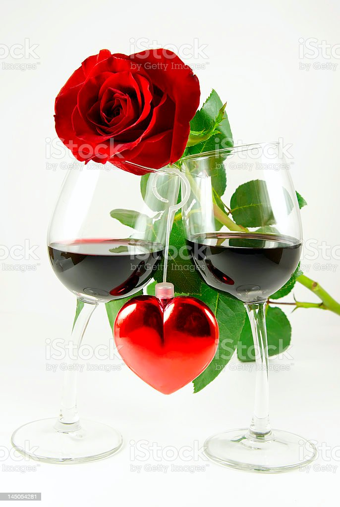 Rose on two glasses and heart royalty-free stock photo