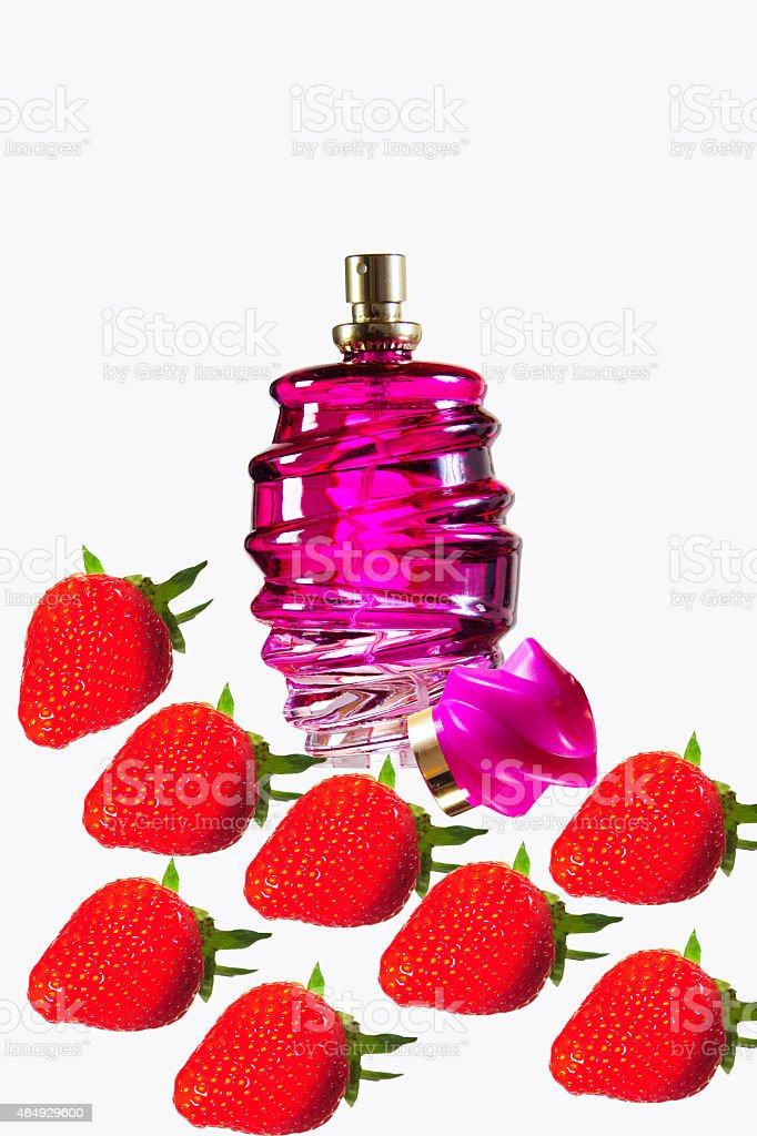 Rose perfume bottle in the foreground white background isolated stock photo