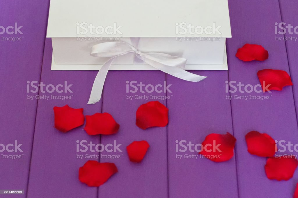 Rose petals and gift box stock photo