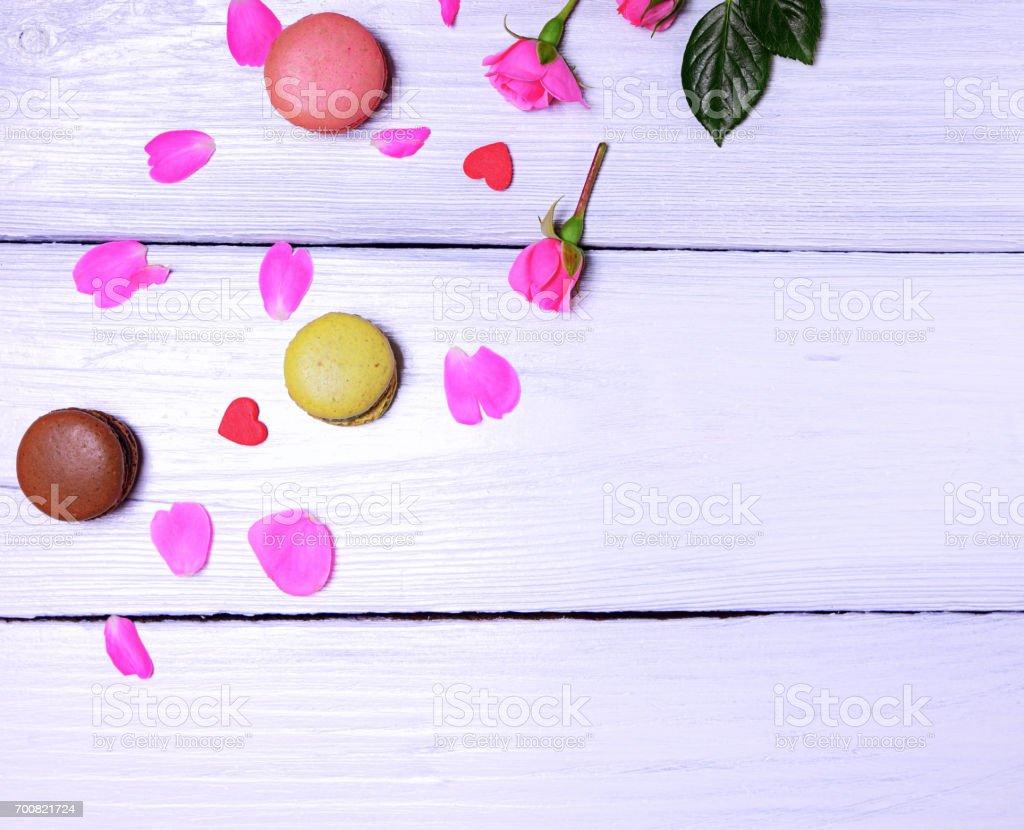 Rose petals and macaroons stock photo