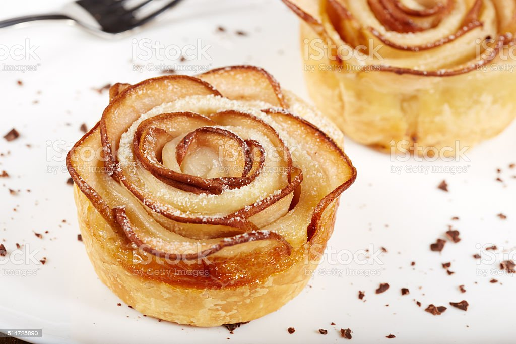 Rose shaped puff pastry cakes with apples stock photo