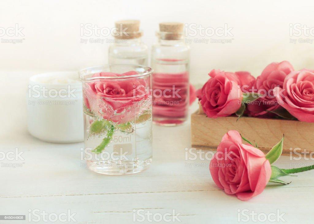 Rose water facial tonic. Fresh pink blossom stock photo